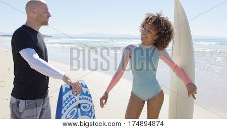 Cheerful people talking on beach