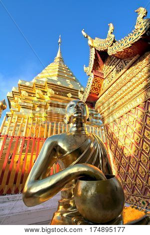 Golden buddha statue and pagoda against clear blue sky at Wat Phra That Doi Suthep A famous Theravada buddhist temple at Chiang Mai Thailand