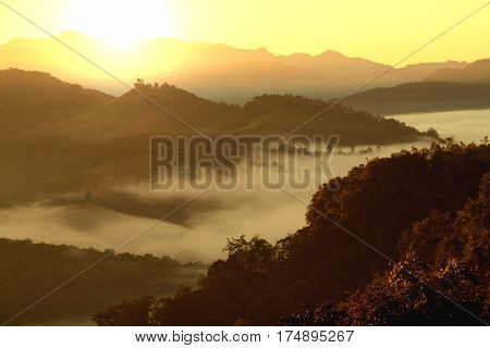 Morning mountain landscape with waves of fog at baan ja bo Mae Hong Son Northern Thailand. Waves of clouds in the mountain peaks covered with coniferous deciduous forests