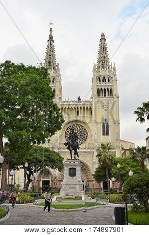 GUAYAQUIL ECUADOR - FEBRUARY 15 2017: Seminario Park and Metropolitan Cathedral. Seminario Park is also known as the Iguana Park since dozens of iguanas live in its ornate gardens.