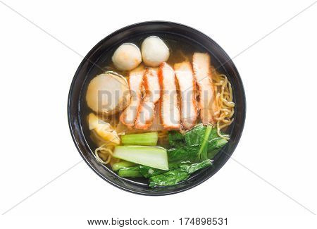 Egg noodle soup with red roast pork in bowl isolated on white background.