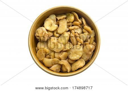 Salted broad beans in bowl isolated on white background.