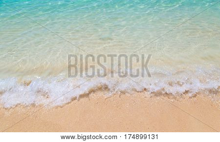 Soft wave of the sea on the sandy beach at Thailand.