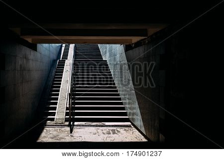 Stairs underpasses in the sunlight dark contrast image
