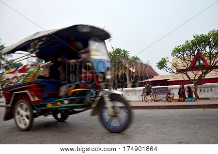 Laotian People Riding Rickshaw Motorcycle Taxi Send Passenger On The Road