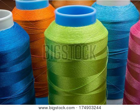 Closeup spools and colored thread sewing for craftsman work.Selective focus colorful thread silk