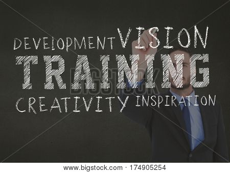 Conceptual image of business training concept against businessman writing in background