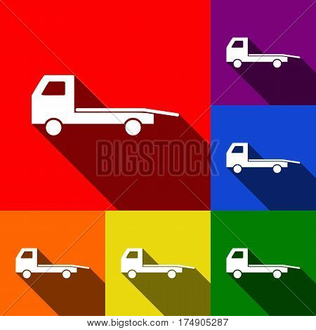 Service of evacuation sign. Wrecking car side. Car evacuator. Vehicle towing. Vector. Set of icons with flat shadows at red, orange, yellow, green, blue and violet background.