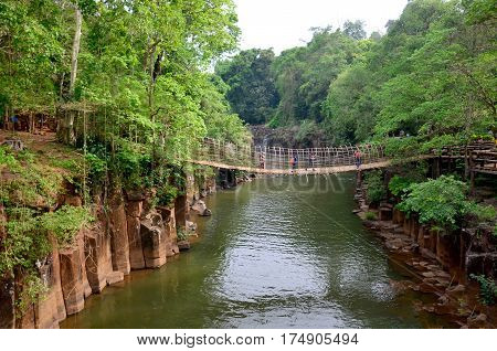 Wooden With Bamboo Bridge For Cross Over Stream River From Tad Pha Suam Waterfalls