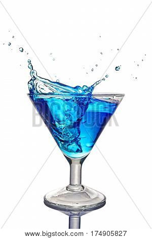 Splash In Glass Of A Blue Alcoholic Cocktail Drink With Ice