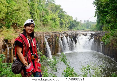 Thai Women Travel And Posing For Portrait At Tad Pha Suam Waterfalls In Pakse