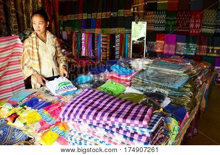 Laotian woman people sale clothes and souvenir at gift shop for sale traveler in Tad Yeang waterfalls nation park at Bolaven Plateau on May 2 2015 in Paksong Champasak Laos.