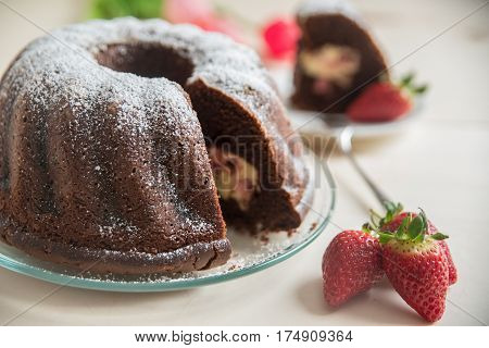 chocolate bundt cake with a strawberry cheesecake filling