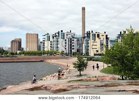 HELSINKI FINLAND - MAY 28 2016: Beautiful view of new residential quarter on a seafront site located on the Munkkisaari peninsula in Helsinki May 28 2016