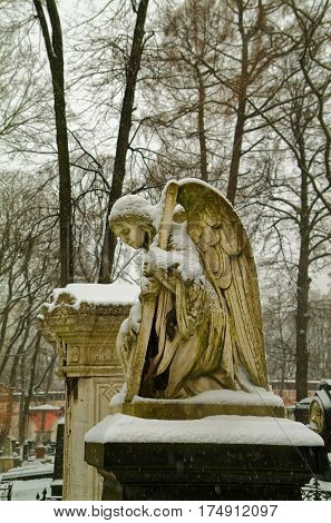 angel statue winter snowfall in the Moscow monastery