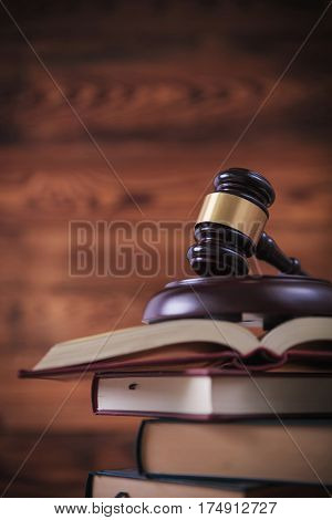 studying law concept, judge's gavel on top of open books , on old wood background