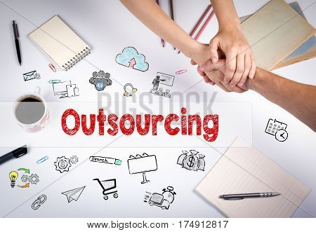 Outsourcing concept. The meeting at the white office table.