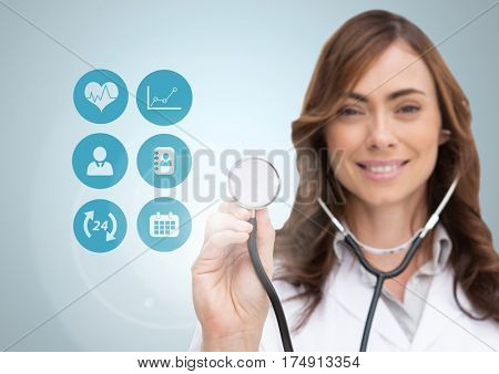 Digital composition of female doctor touching stethoscope on digitally generated medical icons against white background