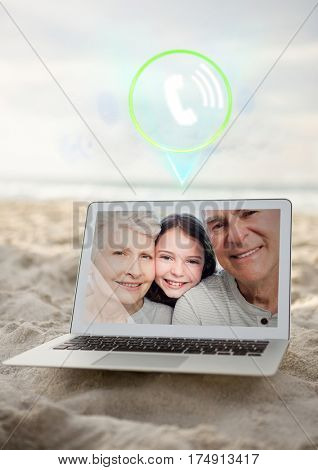 Incoming video call of grandparents and grand daughter on laptop