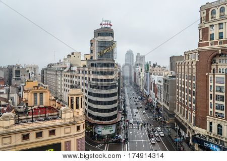 Madrid Spain - November 20 2016: Rainy day in Gran Via in Madrid. It is an ornate and upscale shopping street located in central Madrid. It is known as the Spanish Broadway. High angle view