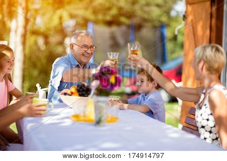Grandparents with grandchild at picnic enjoying