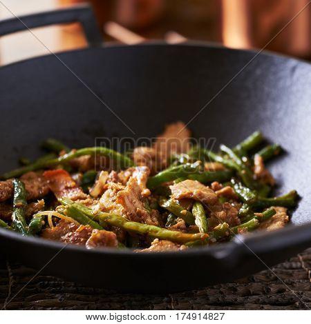 Chinese string bean chicken in cast iron wok