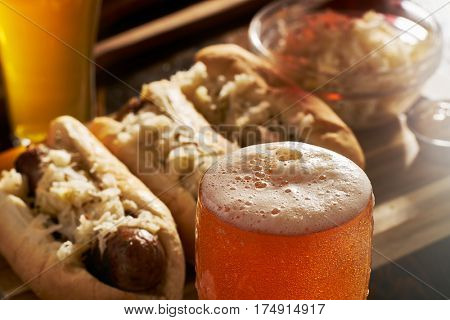 freshlly poured IPA beer in mug served with bratwursts