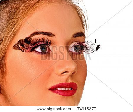 Fake eyelashes and perfect skin facial make-up. Closeup faceof young beautiful white woman with long false eyelashes over white background
