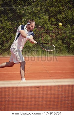 Professionally tennis player serving ball