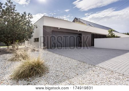 Modernly designed house exterior with double garage