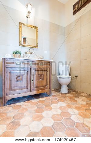 Elegant Bathroom With Toilet And Cabinet