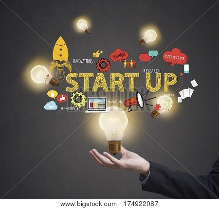 Business worker with light bulb. concept start up new ideas with innovation and creativity.