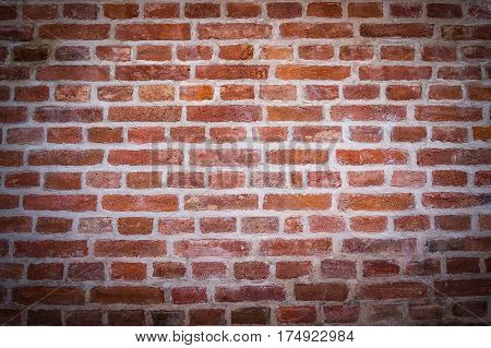 Red brick wall texture background with vignetted corners