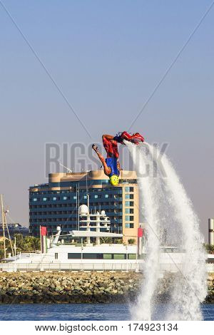 Background view man on flayborde doing Extreme stunt with a coup At competitions on extreme kinds of sports in Sky dive Dubai