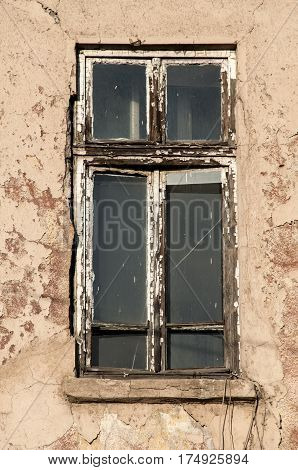 Shabby dirty grunge window of neglected and abandoned old industrial building