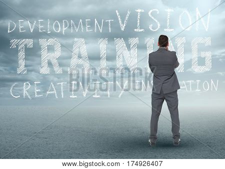 Digitally composite of businessman looking at motivational concept