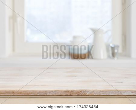 Wooden table top on blurred kitchen window background