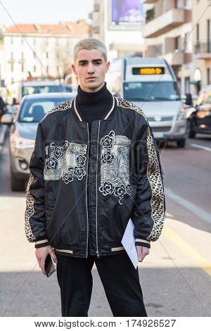 MILAN ITALY - FEBRUARY 25: Fashionable man poses outside Antonio Marras fashion show during Milan Women's Fashion Week on FEBRUARY 25 2017 in Milan.