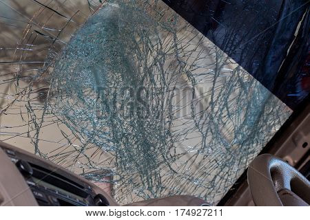 Close Up of a Broken Car Windshield from inside the car