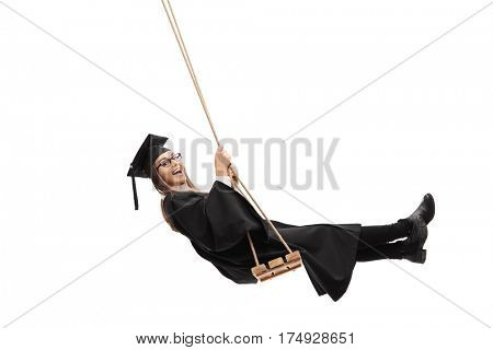Joyful graduate student swinging on a swing