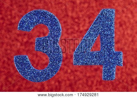 Number thirty-four blue color over a red background. Anniversary. Horizontal