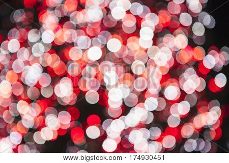 Red and white glitter bokeh lights. Useful as an unfocused background. Copy space area available