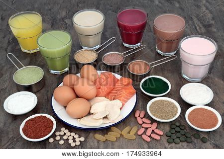 Health food and health drinks for body builders with high protein meat, fish, eggs and supplement powders with vitamin pills.