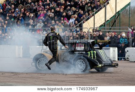 PODINGTON, UK - FEBRUARY 22: Terry Grant demonstrates how to drive a stunt car by doing various tricks for the public at the Santa Pod Raceway Stuntfest event on February 22, 2014 in Podington