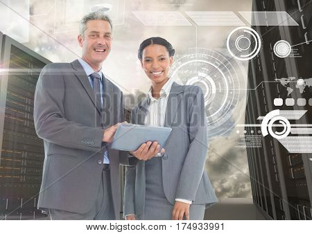 Digitally generated image of businessman and woman using digital tablet in server room