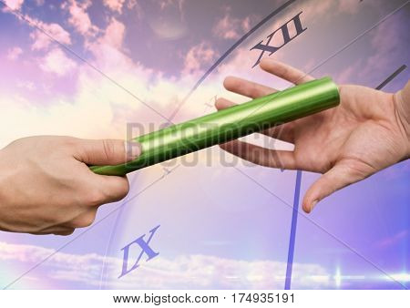 Close-up of hands passing the baton against digitally generated background