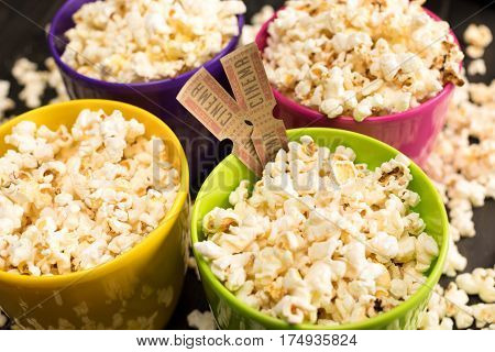 close up view of popcorn in bowls and movie tickets Movie time concept
