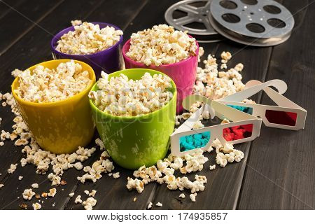 close up view of popcorn in bowls and 3D glasses on table Movie time concept