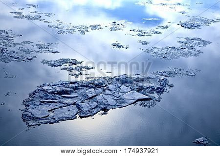 The surface of the river with melting ice.
