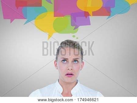 Digital composite image of confused woman with speech bubbles against grey background